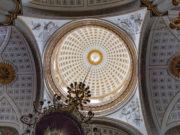 Photo taken straight up from under an interior dome in old church.