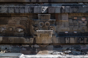 The face of Tlaloc repeats with Quetzalcoatl on the main temple.